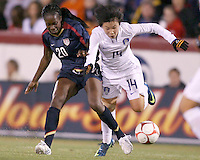 Tina Ellerton (20) of USA knocks the ball away from Go Taehwa (14) of South Korea during an international friendly match at City Stadium on November 1, 2008 in Richmond, Virginia. USA won 3-1. Photo by Tony Quinn / isiphotos.com