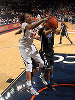 Virginia forward Telia McCall (30) reaches for a rebound during an NCAA college basketball game in Charlottesville, Va. Duke defeated Virginia 62-41...