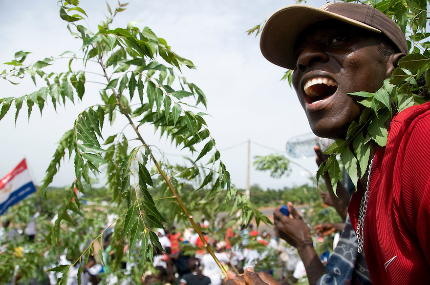 Bissau/June 26 - Nefis Deui yells support for Kumba Yala, a candidate for president in Guinea-Bissau's election.  In the capital city, Bissau, Guinea-Bissau residents rallied for their candidates two days before the elections by dancing and attending speeches...