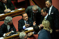 Silvio Berlusoconi e Roberto Calderoli fanno i conti: 57 senatori fino ad ora sembrano essere dalla parte di Berlusconi<br /> Roma 02-10-2013 Senato. Discorso programmatico del Presidente del Consiglio a cui segue un voto di fiducia per risolvere la crisi di governo.<br /> Speech of the italian premier at the senate and voctation to solve the crisis of the government.<br /> Photo Samantha Zucchi Insidefoto