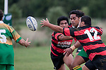 Arron Angareu tries to intercept the pass from Nau Tapui to Richard Kastermans. Counties Manukau Premier Club Rugby Game of the Week between Drury & Papakura, played at Drury Domain on Saturday Aprill 11th, 2009..Drury won 35 - 3 after leading 15 - 5 at halftime.