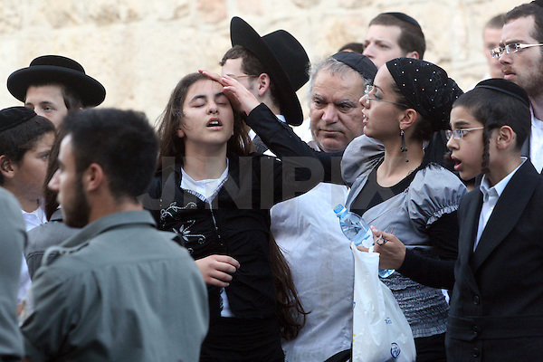 A young ultra orthodox Jewish girl is seen after being lightly wounded during the Sabbath riots, in which thousands of Ultra-Orthodox Jews protested against the opening of a parking lot on the Shabbat day of rest, Jerusalem, Saturday, June 27, 2009. Approximately 40 ultra-Orthodox demonstrators were arrested and six people were wounded during the riots. Photo By : Tess Scheflan / JINI