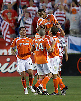 Houston Dynamo teammates Brian Ching (25), Eddie Robinson (2), Wade Barrett (24), and Brian Mullan (9) hoist Ricardo Clark (13) into the air after his unassisted goal at Robertson Stadium in Houston, TX on Saturday May 6, 2006. The Houston Dynamo defeated FC Dallas 4-3.