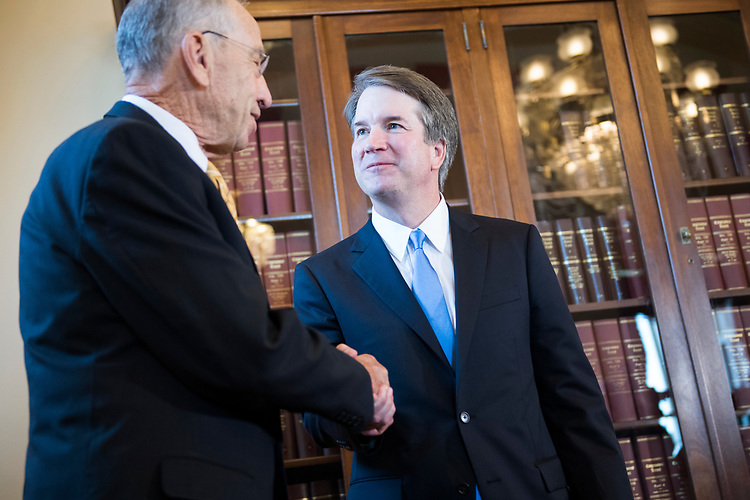 UNITED STATES - JULY 10: Supreme Court nominee Brett Kavanaugh, right, and Senate Judiciary Committee Chairman Charles Grassley, R-Iowa, conduct a photo-op in the Capitol on July 10, 2018. (Photo By Tom Williams/CQ Roll Call)