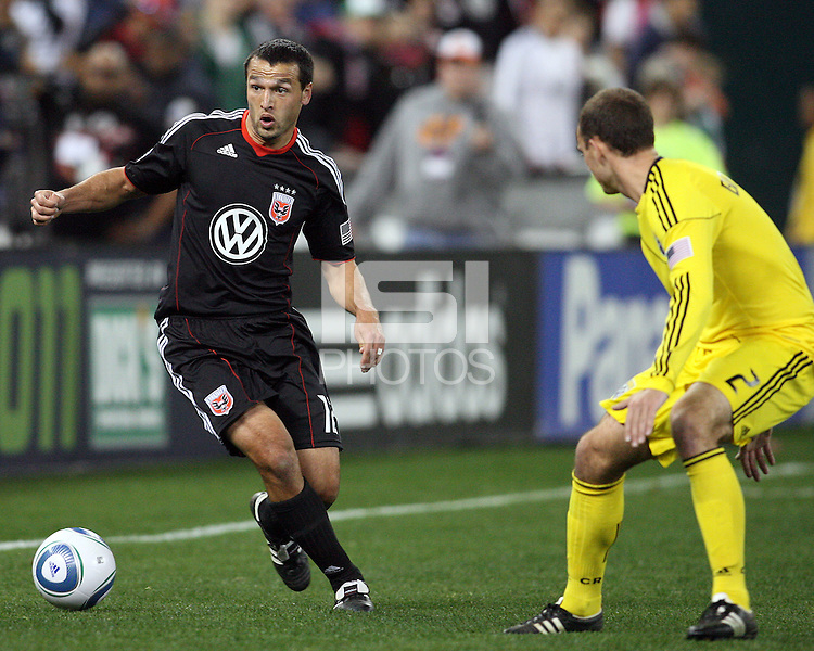 Jed Zayner#12 of D.C. United moves up on Rich Balchan#2 of the Columbus Crew during the opening match of the 2011 season at RFK Stadium, in Washington D.C. on March 19 2011.D.C. United won 3-1.