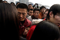 "People wait to enter the grounds of the Memorial Hall of the Nanjing Massacre  in Nanjing, China on Thursday, Dec. 13, 2007. After two years of renovations, the Memorial Hall of the Nanjing Massacre reopened to the public on Dec. 13, 2007, the 70th anniversary of the 6-week massacre by Japanese troops that started Dec. 13, 1937 and claimed more than 300,000 lives.  The commemoration comes amid renewed controversy about the accuracy of historical accounts of the massacre.  The massacre is also known as ""The Rape of Nanking."""