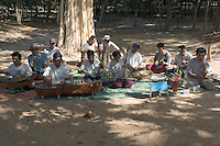 An orchestra composed of landmine victims outside Banteay Srei, Angkor. These people cannot work and donations made to them are their only means of support. The country, and especially the surrounds of the great temples of Angkor, was extensively mined during the Khmer Rouge period and, while clearing goes on, these mines continue to claim victims.