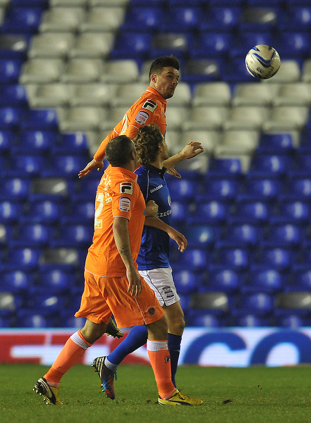 Blackpool's Gary MacKenzie gets to the ball first..Football - npower Football League Championship - Birmingham City v Blackpool - Tuesday 05th March 2013 - St Andrews - Birmingham..© CameraSport - 43 Linden Ave. Countesthorpe. Leicester. England. LE8 5PG - Tel: +44 (0) 116 277 4147 - admin@camerasport.com - www.camerasport.com