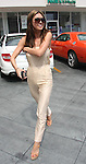 ...4-22-09.Audrina Patridge leaving a photoshoot & driving her new orange dodge challenger in Los Angeles ca wearing a tan jump suit...AbilityFilms@yahoo.com.805-427-3519.www.AbilityFilms.com.