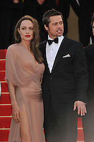 ANGELINA JOLIE &amp; BRAD PITT<br /> The &quot;Inglourious Basterds&quot; Premiere at the Grand Theatre Lumiere during the 62nd Annual Cannes Film Festival, Cannes, France.<br /> May 20th, 2009<br /> length half 3/4 dress sheer wrap beige pink cream black tuxedo couple goatee facial hair slit split thigh red lipstick <br /> CAP/PL<br /> &copy;Phil Loftus/Capital Pictures /MediaPunch ***NORTH AND SOUTH AMERICAS ONLY***