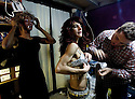 Renowned Palestinian drag queen 'Eman' readies himself backstage in a Jerusalem club, as his protege (a young Palestinian) prepares for his first big performance. Shushan, a popular gay club in Jerusalem-- is frequented by Israelis and Palestinians , where the only wall between the people is a dressing room.