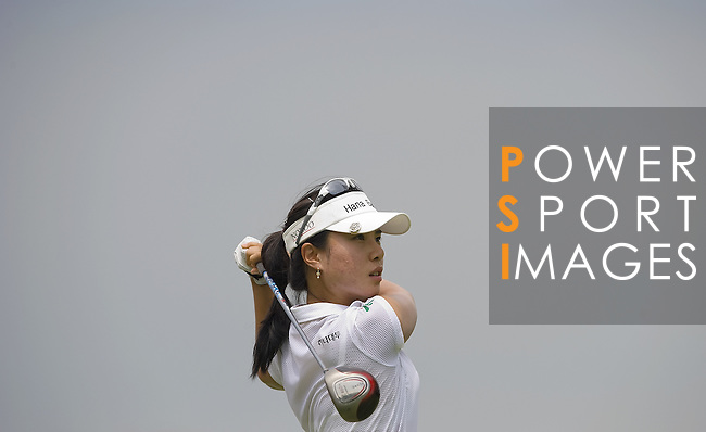 SINGAPORE - MARCH 05:  Hee Young Park of South Korea watches her tee shot on the par four 16th hole during the first round of HSBC Women's Champions at the Tanah Merah Country Club on March 5, 2009 in Singapore.  Photo by Victor Fraile / The Power of Sport Images