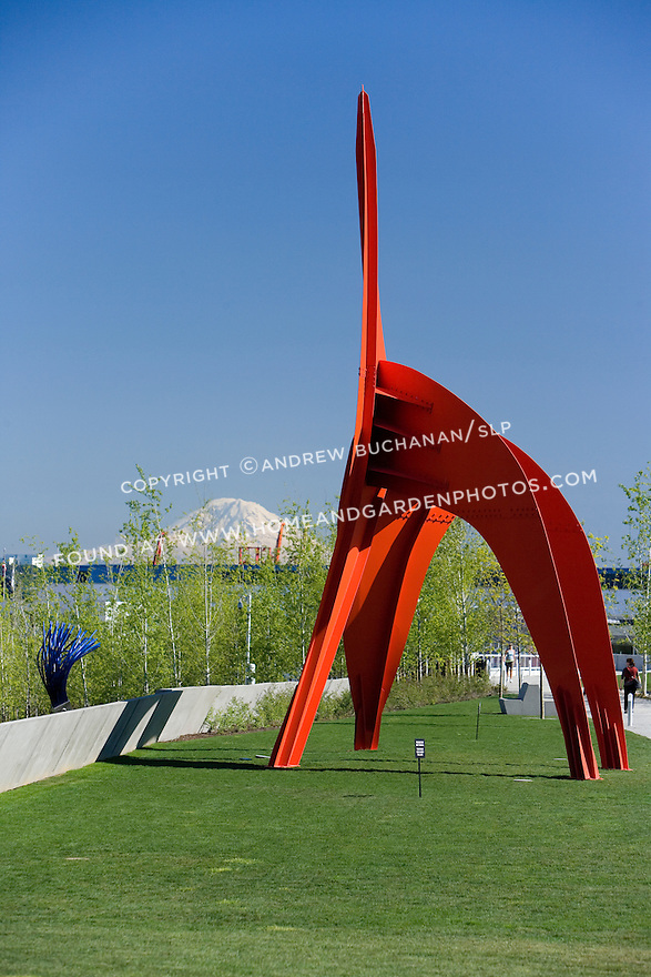 "With snow-capped Mt. Rainier looming some 60+ miles away, the vivid red of Alexander Calder's, ""Eagle, 1971"" contrasts with the vivid blue of a Northwest sky.  SAM's Olympic Sculpture Park, Seattle, WA."