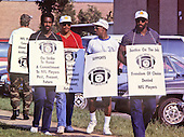 Washington Redskins players, including Art Monk, Mel Kaufman, and Monte Coleman walk the picket line outside Redskins Park in Herndon, Virginia on September 22, 1987, the first day of the NFL players strike.<br /> Credit: Howard L. Sachs / CNP