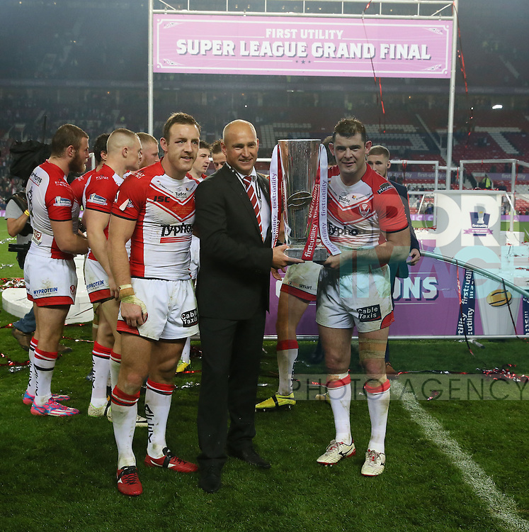 St Helens coach Nathan Brown St Helens Paul Wellens and St Helens James Roby celebrate- First Utility Super League Grand Final - St Helens v Wigan Warriors - Old Trafford Stadium - Manchester - England - 11th October 2014 - Pic Paul Currie/Sportimage