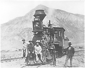 Frontal view of D&amp;RG #32 &quot;Kit Carson&quot; at Crested Butte with seven men posing.  This Consolidation was built by BLW in 1878 as their No. 4385. It was leased to DSP&amp;P from July, 1879 until January, 1880, then to the Pueblo Steel Works from September 28, 1882 until February 22, 1884 and Florence &amp; Cripple Creek during February, 1894.  Dismantling occurred June 30, 1908.<br /> D&amp;RG  Crested Butte, CO