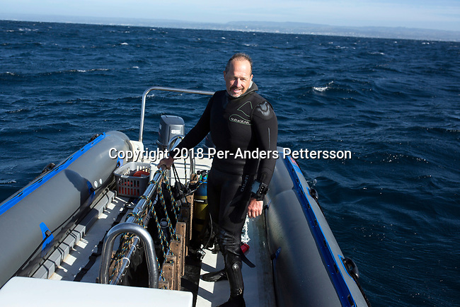 MARGATE, SOUTH AFRICA APRIL 25: Shark expert and biologist Erich Ritter stands in a boat during a diving excursion, with an African Adventure diving boat, during an early morning dive at Protea Banks on April 25, 2018 in KwaZulu Natal, South Africa. The area is one of the best in South Africa for shark encounters. (Photo by: Per-Anders Pettersson/Getty Images)