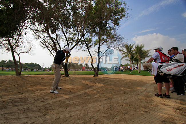 Martin Kaymer has to play a wayward shot from the boonies on the 8th hole during Day 3 Saturday of the Abu Dhabi HSBC Golf Championship, 22nd January 2011..(Picture Eoin Clarke/www.golffile.ie)