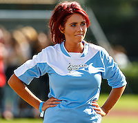 London, UK on Sunday 31st August, 2014. Amy Childs stands with her hands on her hips during the Soccer Six charity celebrity football tournament at Mile End Stadium, London.