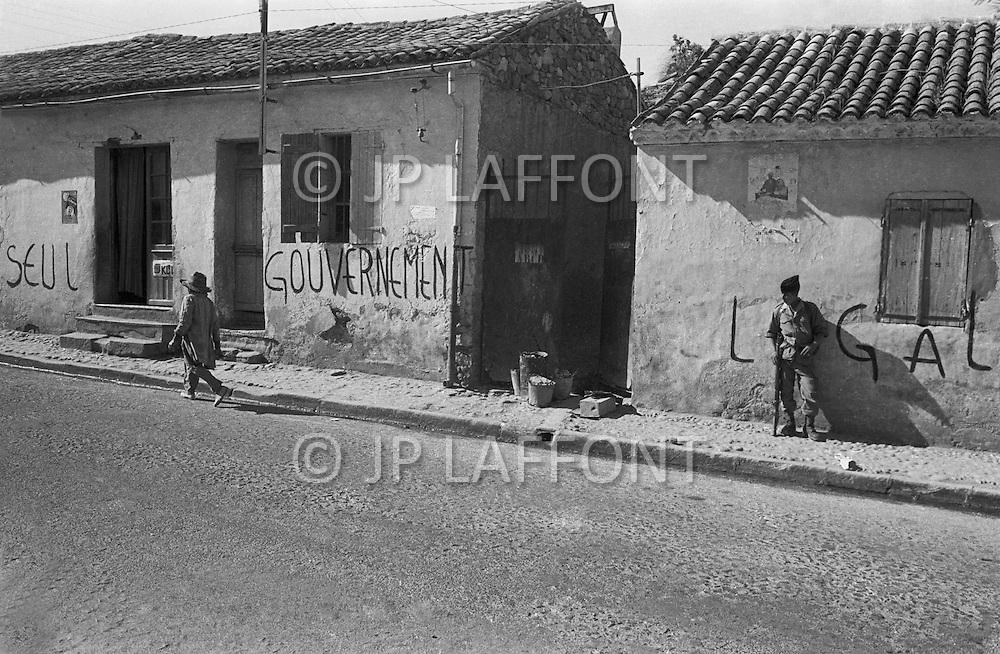Dublineau, Mascara area, April 1961. Main Street and Pro De Gaulle Propaganda on the wall.