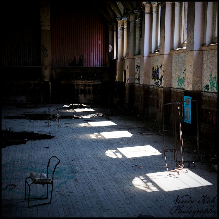 Light coming in through a row of windows into the grand hall