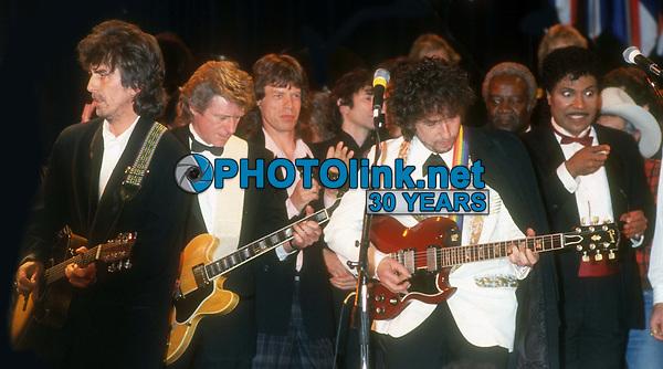 George Harrison Mick Jagger Bob Dylan Little Richard 1988<br /> Rock and Roll Hall of Fame<br /> Photo By John Barrett/PHOTOlink