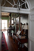 One of several doorways opening into the entrance hall features double doors with a fanlight window above