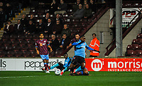 Fleetwood Town's defender Amari'i Bell (3) just beaten to the ball by Scunthorpe Utd's defender Jordan Clarke (2)during the Sky Bet League 1 match between Scunthorpe United and Fleetwood Town at Glanford Park, Scunthorpe, England on 17 October 2017. Photo by Stephen Buckley/PRiME Media Images