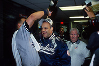 OAKLAND, CA:  Derek Jeter of the New York Yankees pours champagne over the head of manager Joe Torre after  Game 5 of the ALDS against the Oakland Athletics at the Oakland Coliseum in Oakland, California on October 8, 2000. (Photo by Brad Mangin)