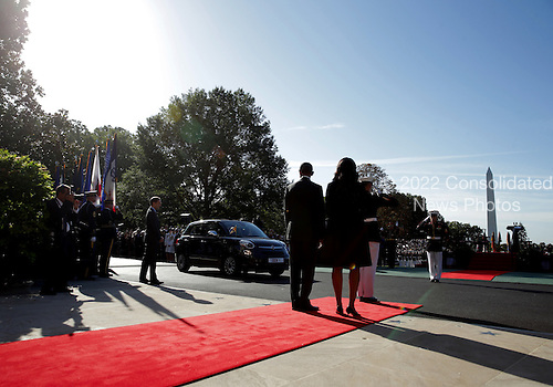 U.S. President Barack Obama and first Lady Michelle Obama await for the arrival of Pope Francis prior to his ceremony at the White House on September 23, 2015 in Washington, DC. The Pope begins his first trip to the United States at the White House followed by a visit to St. Matthew's Cathedral, and will then hold a Mass on the grounds of the Basilica of the National Shrine of the Immaculate Conception.<br /> Credit: Alex Wong / Pool via CNP