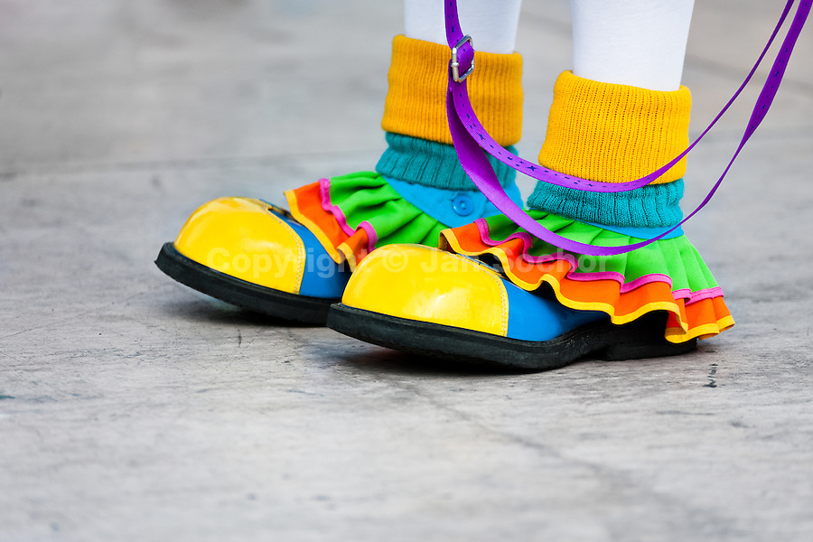 A female clown wears oversized colorful shoes during the Clown Congress in San Salvador, El Salvador, 18 May 2011. The clown performance is considered a regular job in most of Latin American countries. Clowns may work individually or in groups, often performing advertisement like acts in large open-to-street shops or they take part in private shows, like children birthdays, family events etc. There are many clown conventions all over Latin America where clowns gather and exchange their experiences offering workshops of the comic acting or the art of make-up. For some of them, being clown is a serious lifetime profession.