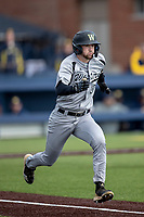 Western Michigan Broncos shortstop Drew Devine (3) runs to first base against the Michigan Wolverines on March 18, 2019 in the NCAA baseball game at Ray Fisher Stadium in Ann Arbor, Michigan. Michigan defeated Western Michigan 12-5. (Andrew Woolley/Four Seam Images)