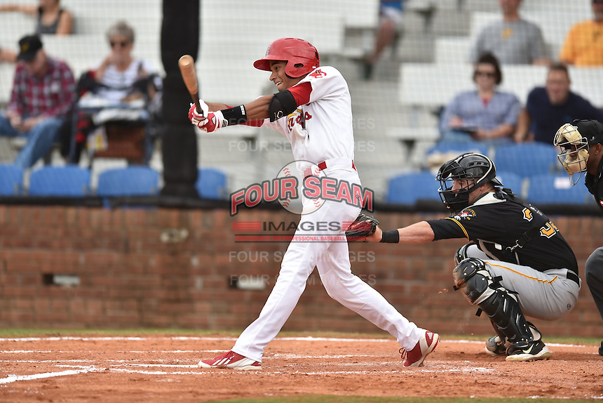 Johnson City Cardinals shortstop Oscar Mercado #4 swings at a pitch during a game against the Bristol Pirates at Howard Johnson Field July 20, 2014 in Johnson City, Tennessee. The Pirates defeated the Cardinals 4-3. (Tony Farlow/Four Seam Images via AP Images)