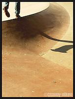 Loan skater walking along ridge @ skatepark/Seattle Ctr.