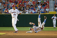 South Carolina SS Bobby Haney shows the ball to the umpire while UCLA's Niko Gallego tumbles on second base in Game Two of the NCAA Division One Men's College World Series Finals on June 29th, 2010 at Johnny Rosenblatt Stadium in Omaha, Nebraska.  (Photo by Andrew Woolley / Four Seam Images)