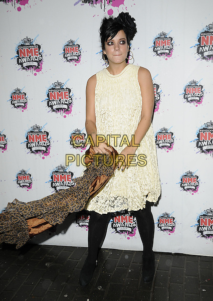 LILY ALLEN.The Shockwaves NME Awards 2010 held at Brixton Academy, London, England. .February 24th, 2010.full length white cream lace dress brown leopard print coat black tights sleeveless .CAP/CAN.©Can Nguyen/Capital Pictures.