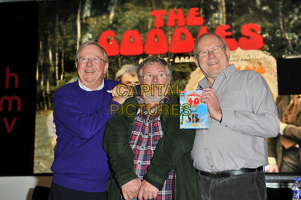 THE GOODIES - Tim Brooke-Taylor, Bill Oddie & Graeme Garden.The Goodies 40th anniversary DVD launch at HMV, Oxford Street, London, England..half length blue green red check shirt glasses beard facial hair hands grey gray.CAP/MAR.© Martin Harris/Capital Pictures.