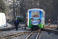 Newly refurbished passenger car is seen after being lifted with a crane onto the track at the Children's Railway head station Huvosvolgy in Budapest, Hungary on Dec. 11, 2019. ATTILA VOLGYI