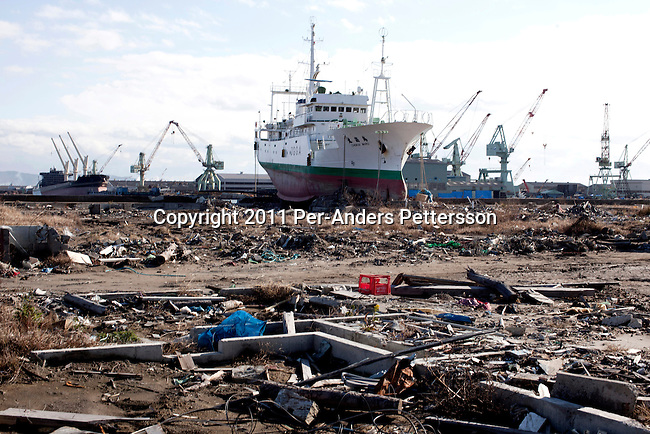 OMAGARIHAMA, JAPAN - DECEMBER 5: A ship stranded on the shore next to a wiped out residential are on December 5, 2011, in the port of Omagarihama, Japan. The small town was almost wiped off the map during the tsunami Northeastern Japan's coastline was struck by an earthquake measuring 9.0 on the Richter scale and a Tsunami on March 11, 2011 which destroyed villages and livelihoods for hundreds of thousands of people. Almost 16,000 dead, thousands missing, more than 700,000 properties destroyed and an estimated 387,000 survivors lost their homes. Its estimated that it will take more than five years to rebuild. The cost is estimated to 309 billion U.S. dollars, the world's most expensive natural disaster. Many children suffered especially with school destroyed, education interrupted and the loss of family members took a heavy toll. (Photo by Per-Anders Pettersson)