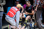 August 20, 2016 - Leadville, Colorado, U.S. -  Medical personnel attend to a runner at the Twin Lakes aid station during the Blueprint for Athletes Leadville Trail 100, Leadville, Colorado.  Considered one of the most challenging endurance races in the world, ultra distance runners will navigate high altitude trails, challenging river crossings, and a variety of changing weather with an elevation gain of more than 18,000 feet ranging from 9200 feet near Twin Lakes to 12,600 feet atop the high point of Hope Pass.