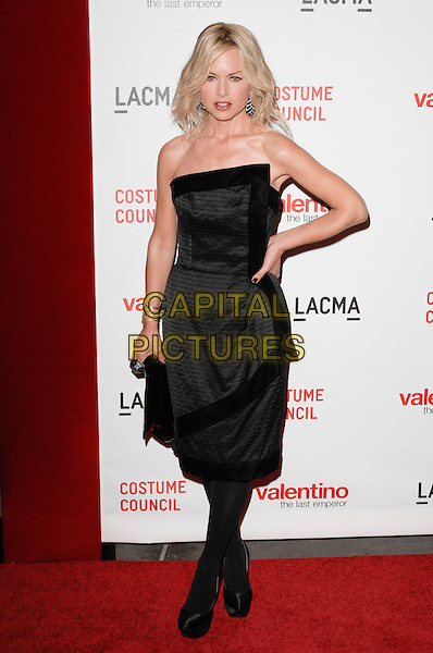 "RACHEL ZOE .The West Coast premiere of ""Valentino: The Last Emperor"" at the Los Angeles County Museum of Art (LACMA), Los Angeles, California, USA..April 1st, 2009.full length black dress hand on hip clutch bag strapless tights .CAP/ROT.©Lee Roth/Roth Stock/Capital Pictures"