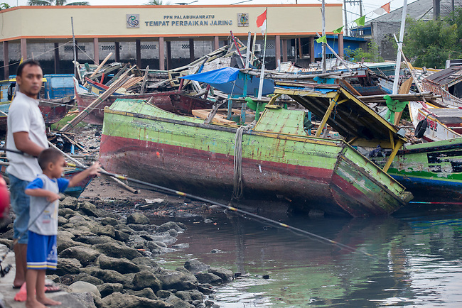 13 February 2019,Pelabuhan Ratu,Sukabumi Regency, West Java, Indonesia. Discarded fishering boats that are no longer economically viable in the crowded fishing port at Pelabuhan Ratu. Since  crackdown on people smuggling and fishing of protected species, locals say they are too expensive to run.The local fisherman say that people smugglers have not been active in the area for a long time in the wake of the Australian Government's concern that boats will once again start trafficking people to Australia with the new Medical legislation that has been passed. Picture by Graham Crouch/The Australian