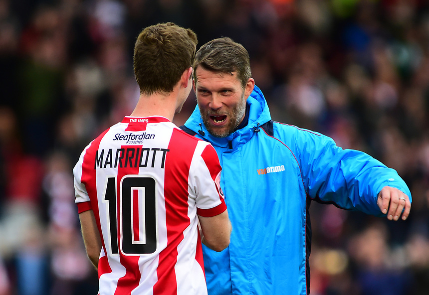 Lincoln City's goalkeeping coach Jimmy Walker celebrates the victory with Lincoln City's Adam Marriott<br /> <br /> Photographer Andrew Vaughan/CameraSport<br /> <br /> Vanarama National League - Lincoln City v Chester - Tuesday 11th April 2017 - Sincil Bank - Lincoln<br /> <br /> World Copyright &copy; 2017 CameraSport. All rights reserved. 43 Linden Ave. Countesthorpe. Leicester. England. LE8 5PG - Tel: +44 (0) 116 277 4147 - admin@camerasport.com - www.camerasport.com