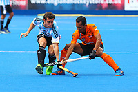 Argentina's Diego Paz and Malaysia's Marhan Jalil compete for the ball during the Hockey World League Semi-Final match between Argentina and Malaysia at the Olympic Park, London, England on 24 June 2017. Photo by Steve McCarthy.