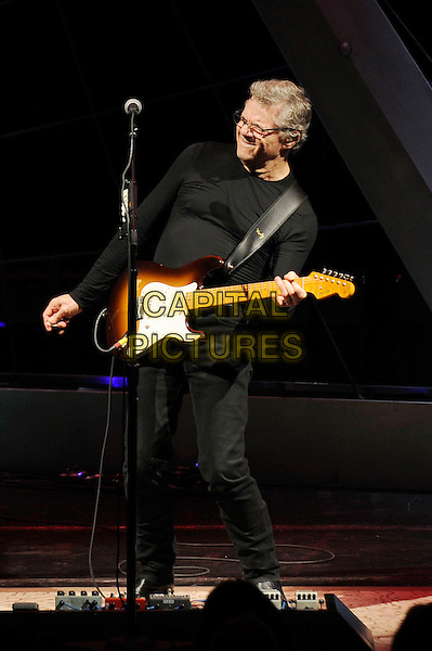 Steve Miller .Steve Miller Band performing live in concert, Roundhouse, Camden, London, England, UK, 20th October 2012..music live in concert gig on stage full length playing guitar black top jeans glasses microphone leaning back .CAP/MAR.© Martin Harris/Capital Pictures.