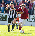 Linlithgow's Roddy Maclennan tries to get away from Ryan Cowie.