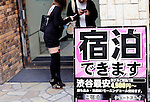 A sign welcomes guests to a love hotel in the Dogenzaka entertainment district -- sometimes referred to as Love Hotel Hill -- of Tokyo, Japan on Sunday 19 April  2009. .Photographer: Robert Gilhooly