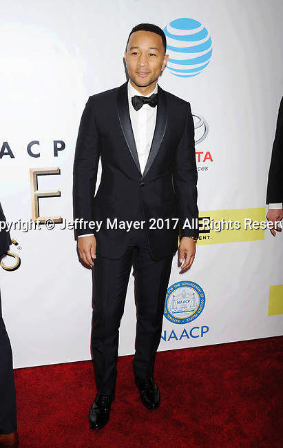 PASADENA, CA - FEBRUARY 11: Singer-songwriter John Legend arrives at the 48th NAACP Image Awards at Pasadena Civic Auditorium on February 11, 2017 in Pasadena, California.