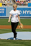 LOS ANGELES, CA. - September 19: Jenna Elfman throws the ceremonial first pitch at the Dodger game at Dodger Stadium on September 19, 2009 in Los Angeles, California.