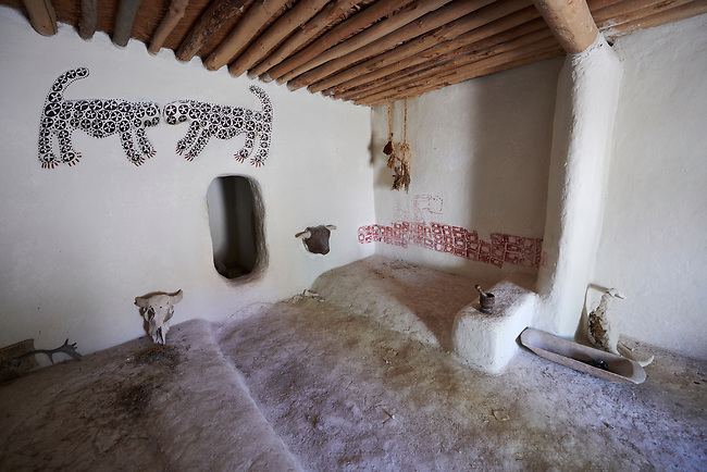 Reconstruction of 4 Catalhoyuk houses to help archaeologists understand the finished structure of excavated ruins. The leopard frescoes on the wall were not found in this room reconstruction. 7500 BC to 5700 BC, Catalyhoyuk Archaeological Site, Çumra, Konya, Turkey